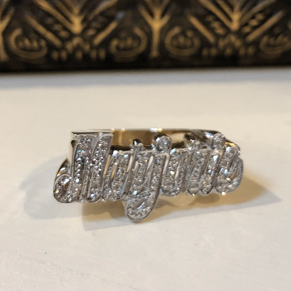 gold name ring with diamonds