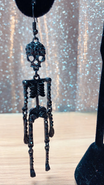Infatuated with these gorgeous black crystal skeleton earrings