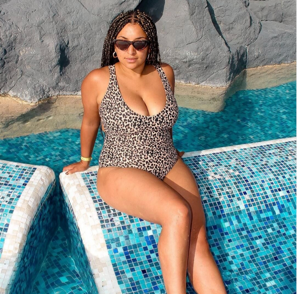 Mixed race girl in swimwear in pool
