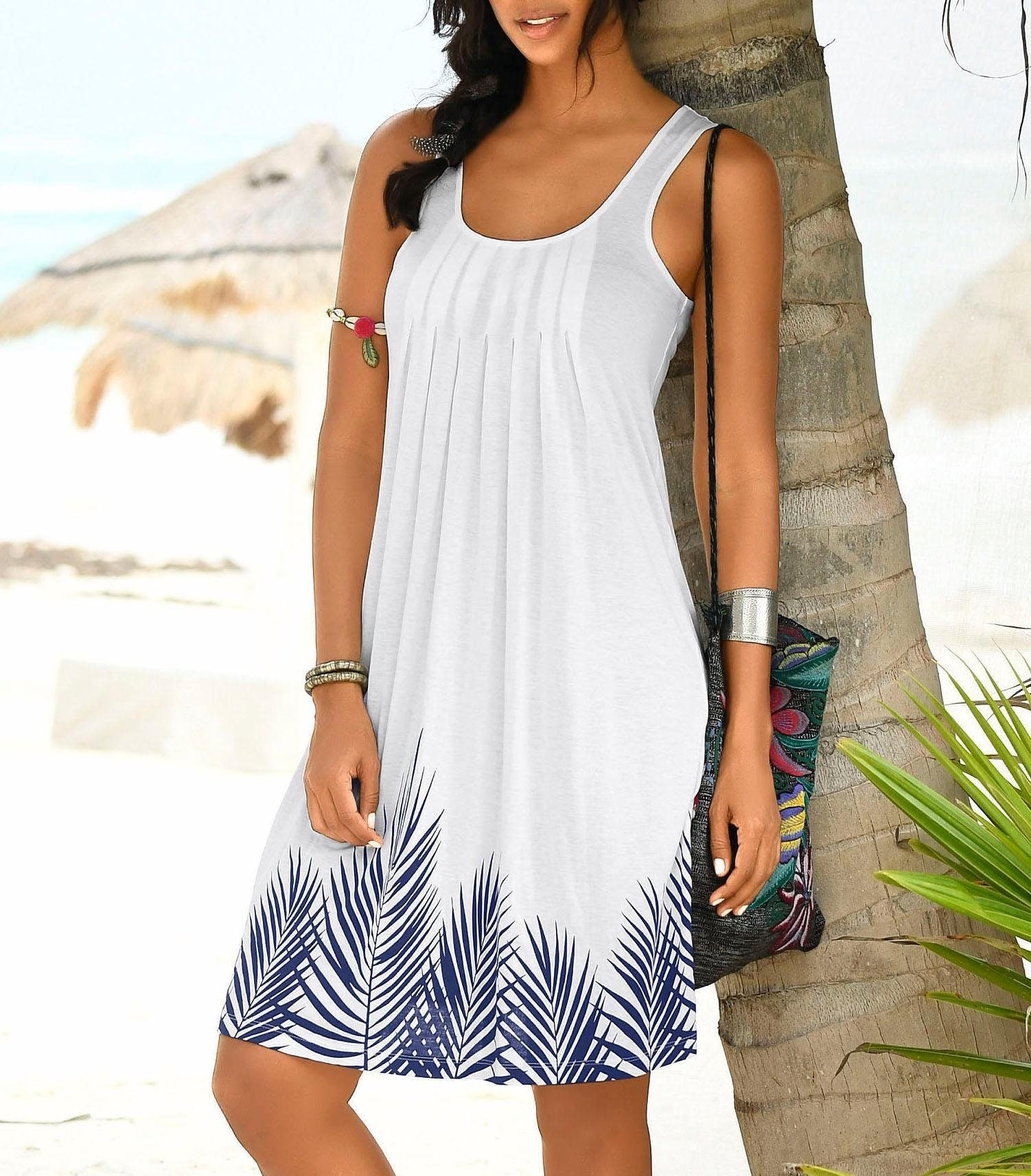 Noticeable beach dress with foliage