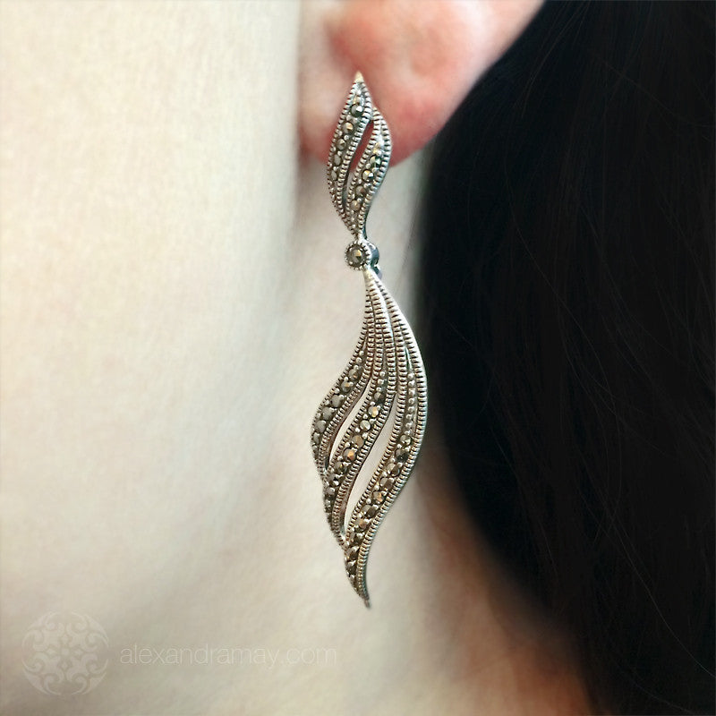 Luke-Stockley-silver-Marcasite-Long-plain-feather-scroll-earrings-SME1104 model