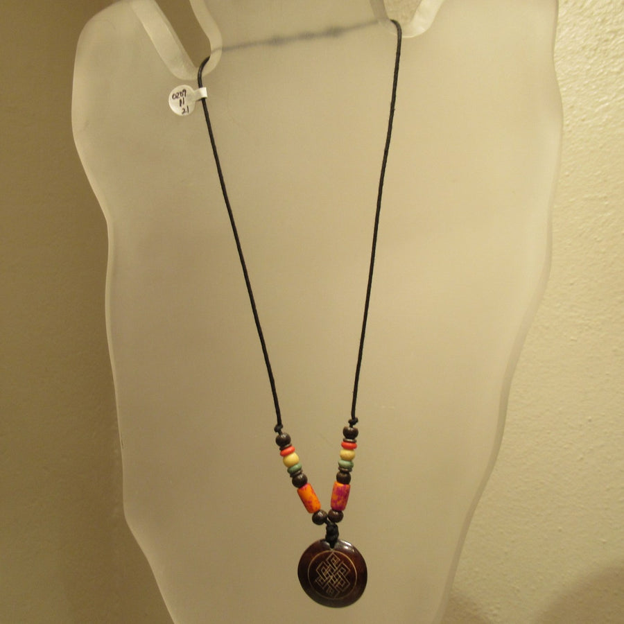 Disc Carved Brown Cord necklace