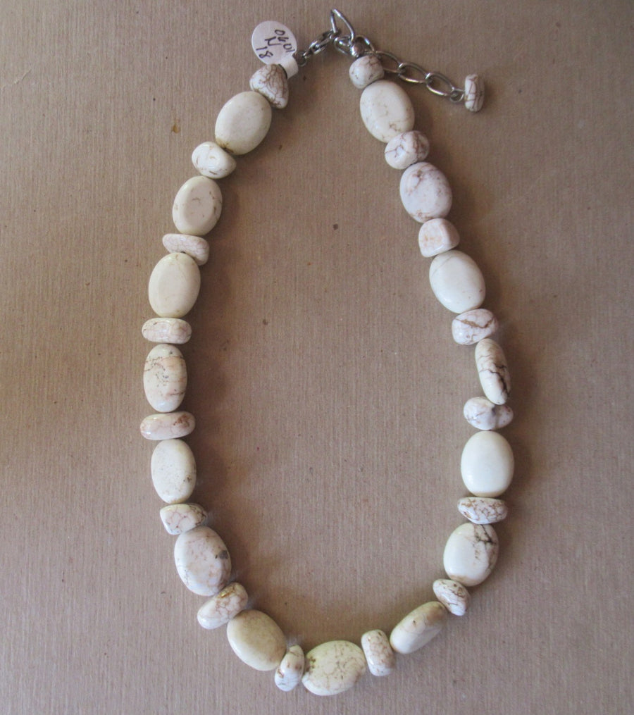 Silver toned Oval Ivory Beaded necklace
