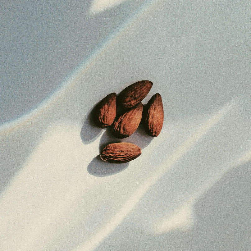 Magnesium pictured as five almonds clustered together on a white table