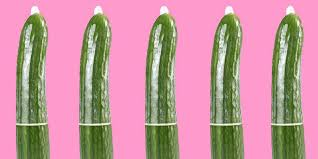 five-cucumbers-wearing-condoms-on-a-pink-background