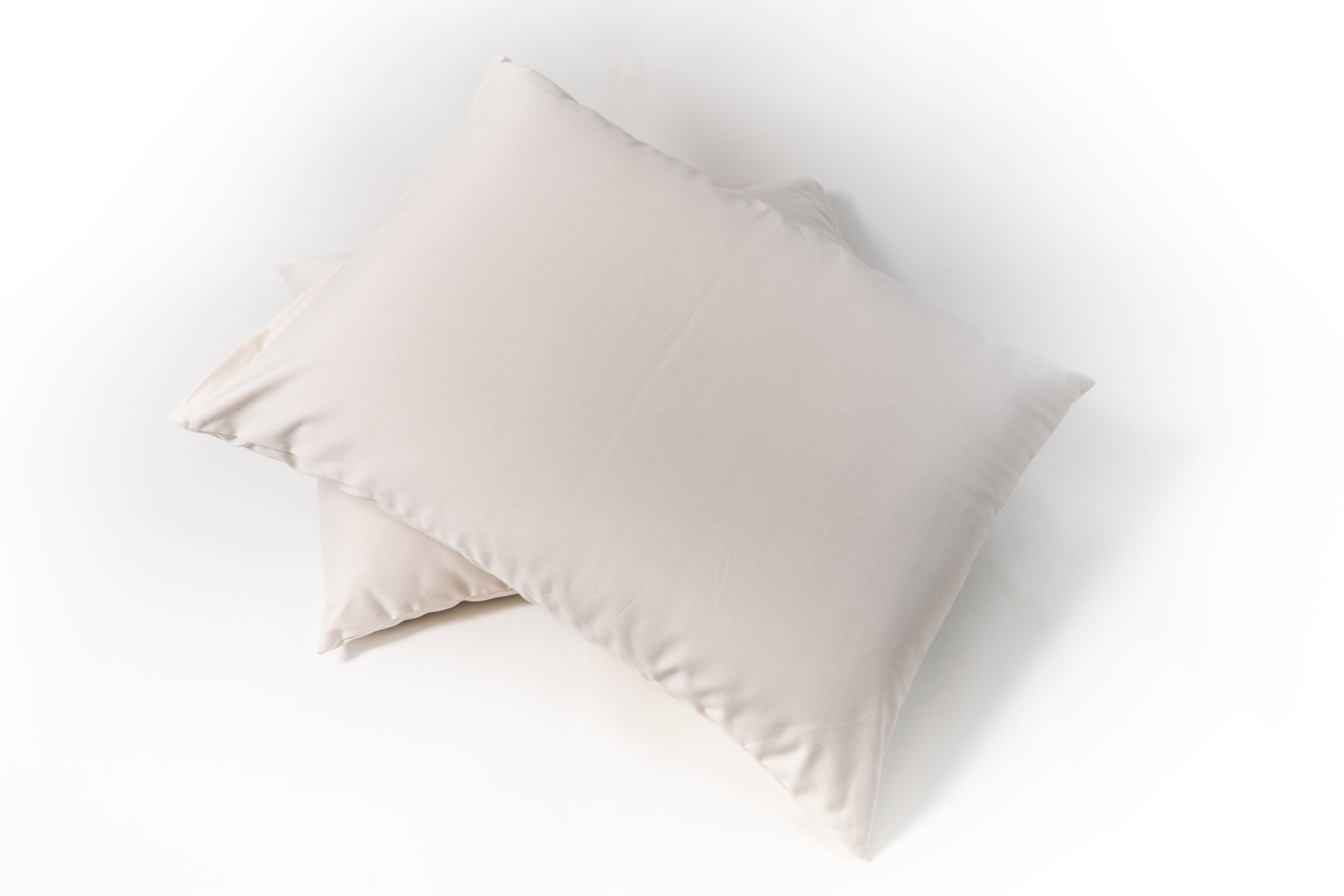 Natural Latex and wool pillow. Covered in a sateen fabric of organic cotton fibers.