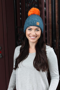 Blue fleece lined knit hat with pom accent
