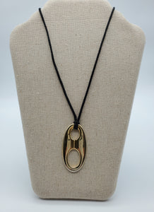 Gold Pendant on Black Cord