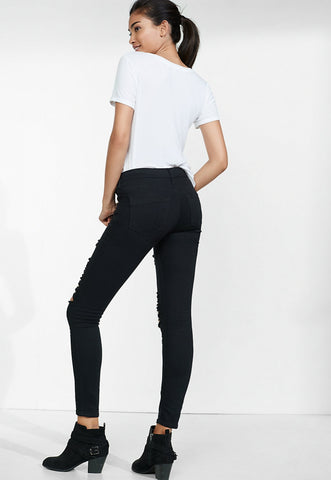 distressed black mid rise jean legging