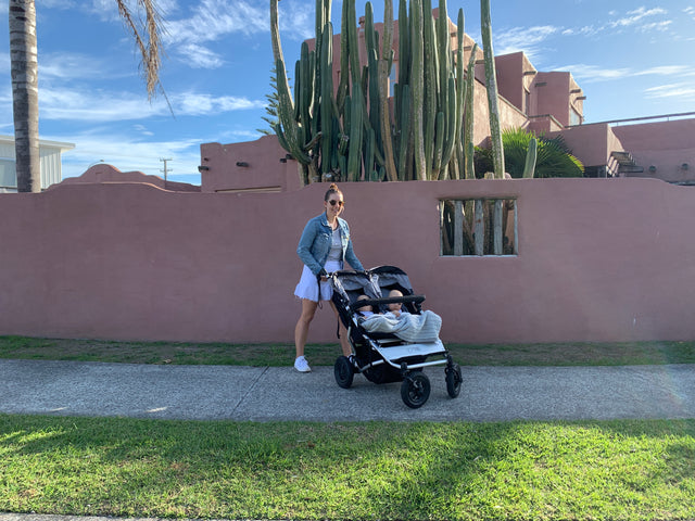 Megan Raynor pushing twins in Mountain Buggy Duet