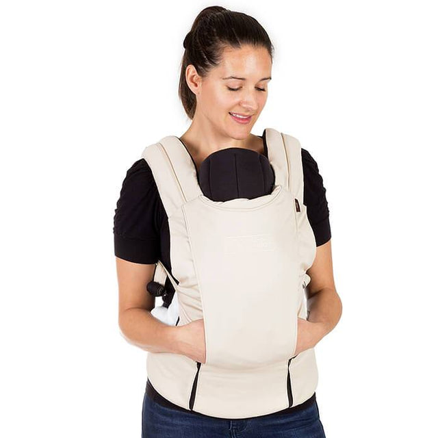 mountain buggy juno baby carrier in sand beige colour with infant insert in use_sand