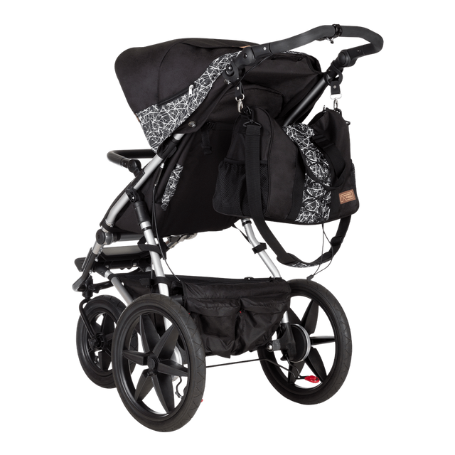 Mountain Buggy duffel bag attached to a terrain buggy in colour graphite_graphite