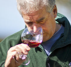 Paul sticks his schnozz in a glass of pinot noir