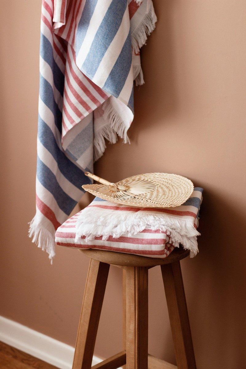 Luzia Peshtemal Beach and Pool Towel in Blue and Red Hung on Wall