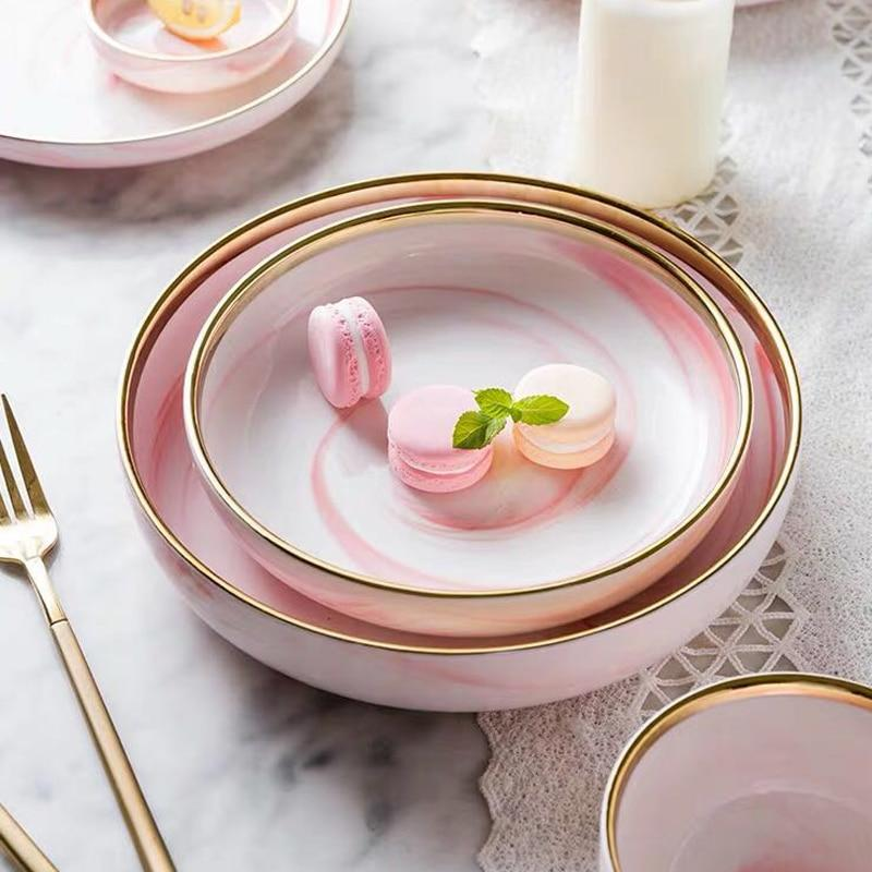Pink marble plates with pink macaroons