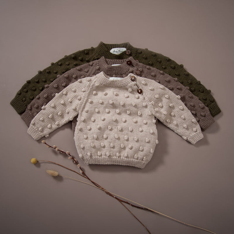 hand knit sweaters in moss, nutty brown, oats. Sizes from baby to 8 years, bubble style.