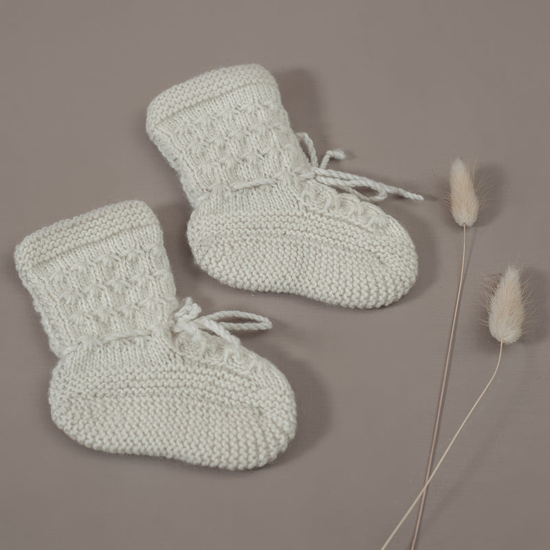 flat lay picture of classic footies cream white