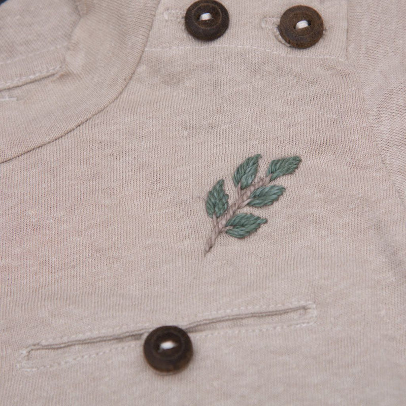 Detail picture of hemp cotton t-shirt oats focusing on leaf embroidery