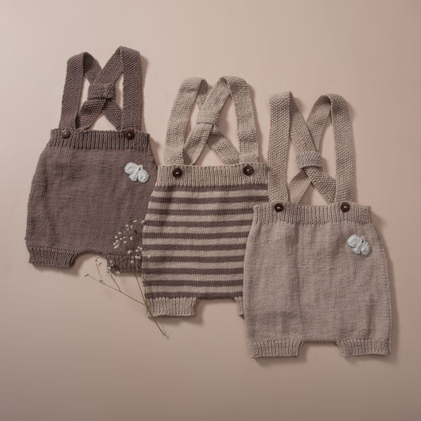 flat lay picture of hand knitted suspenders in nutty brown, oats with nutty brown stripes and oats