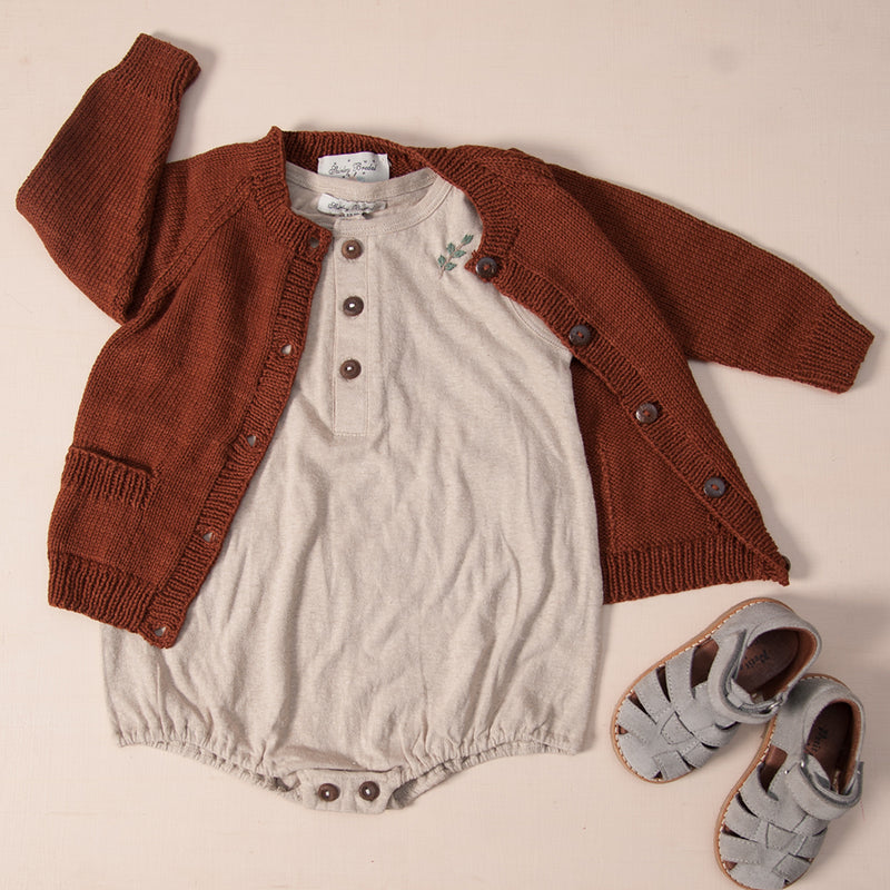 baby romper in hemp cotton oats with hand knitted cardigan in rust