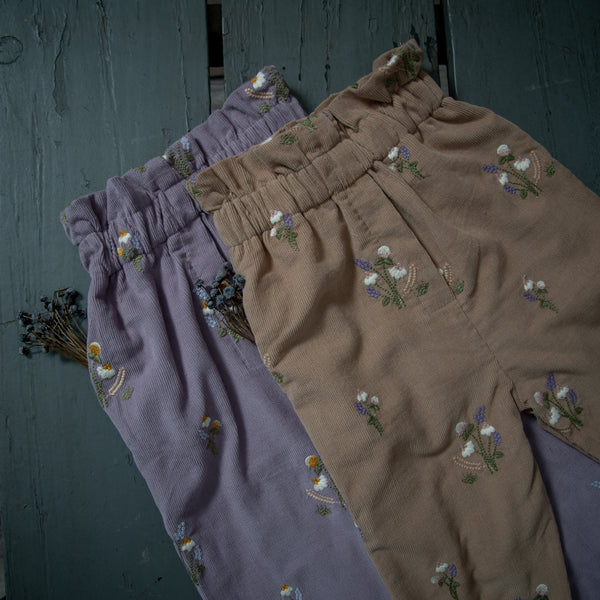 nude and lavender pants for kids with embroidered flowers