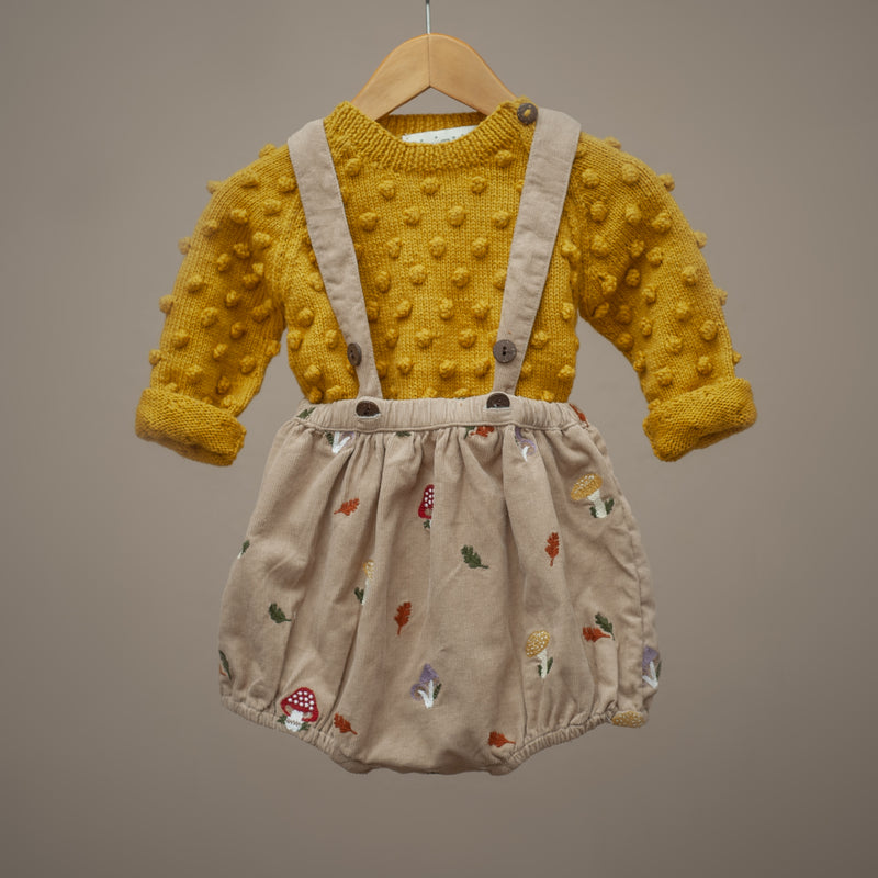 corduroy embroidered suspender shorts styled with yellow knitted sweater for kids