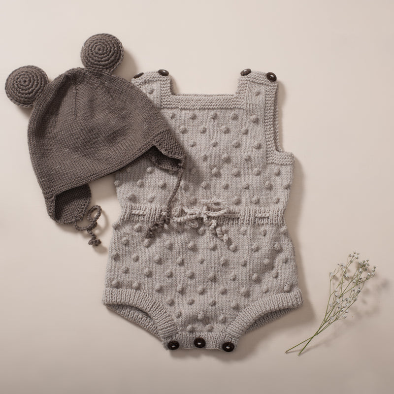 flatlay picture of bubble romper oats and remy mouse hat in nutty brown