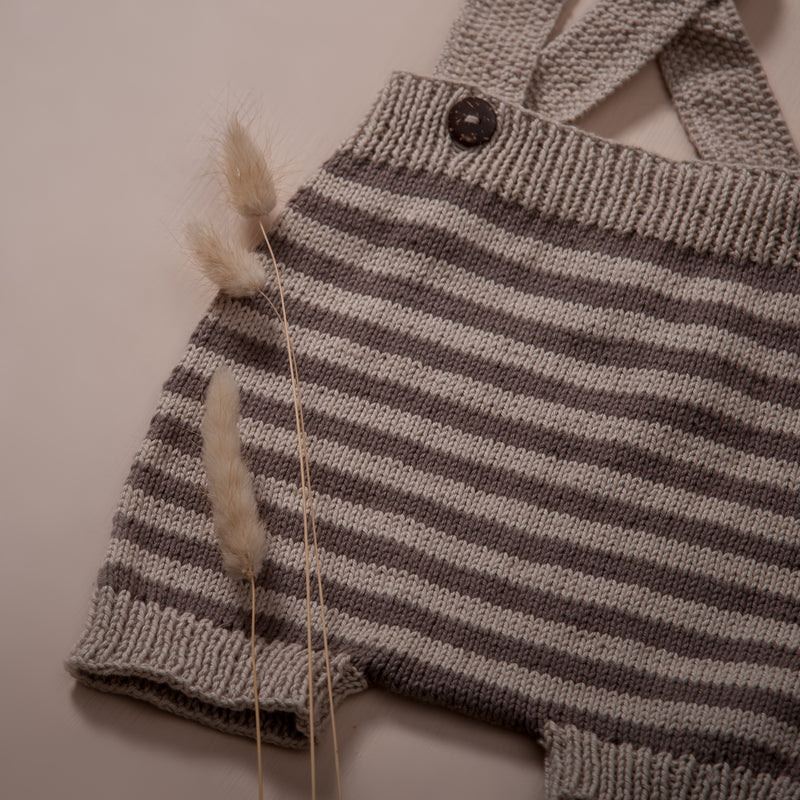 detail picture of hand knitted suspender shorts oats with nutty brown stripes