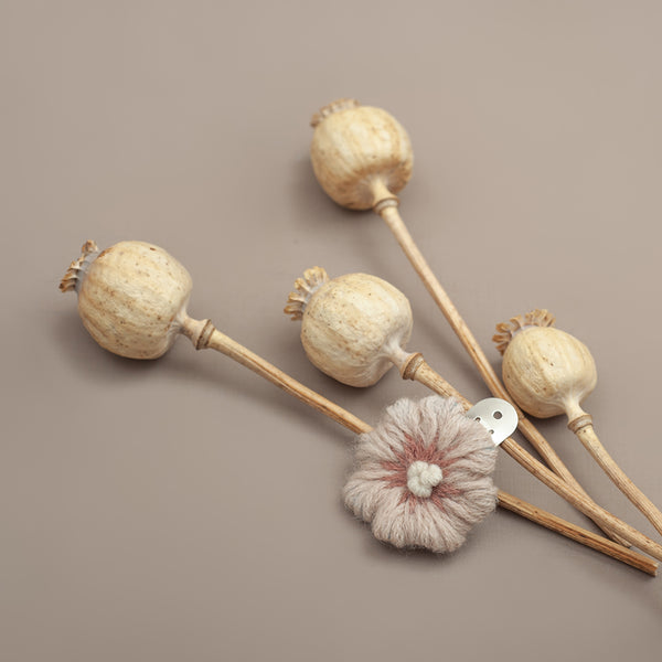 Practical and easy snap clips, embellished with our sweet hand-embroidered flora flowers.