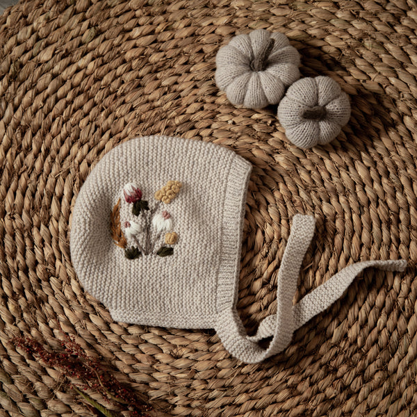hand knitted bonnet in nude colour with embroidered florals for kids and babies