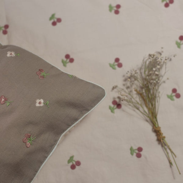 kids and baby bedding in dusty pink colours with embroidered cherries