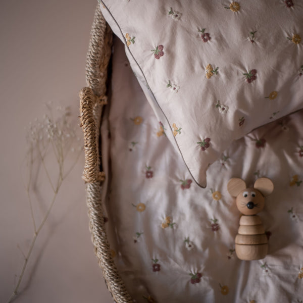 kids and baby bedding in dusty pink colours with embroidered flowers