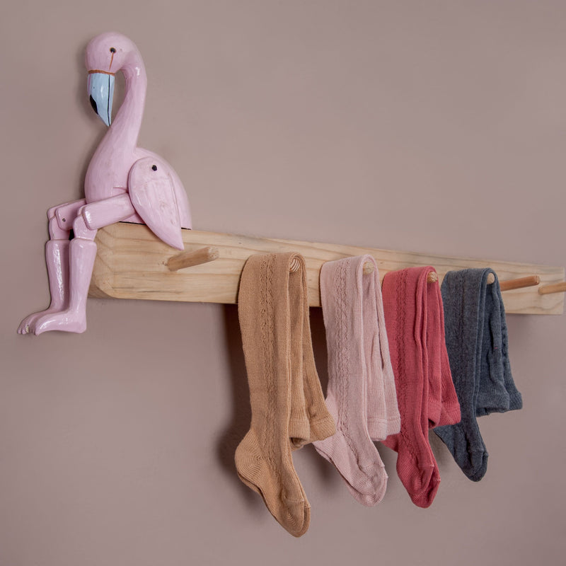 different coloured rib tights in hole pattern hanged in coat  rack