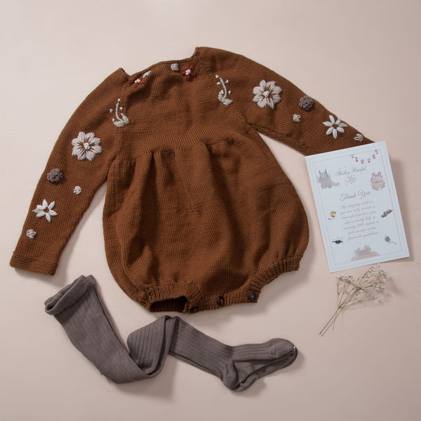 flay lay picture of baby leggings taupe along with flora romper caramel
