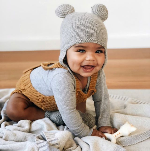 toddler wearing hand knitted hat with ears on it