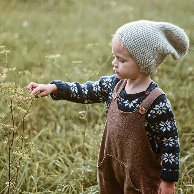 baby boy wearing beautifully hand knitted everyday hat with his wonderful outfit