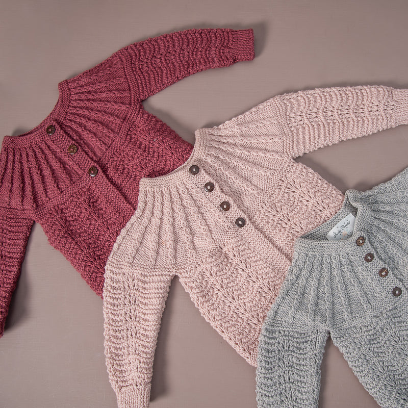 Flat lay picture of edith cardigan deep berry, dusty pink and light grey