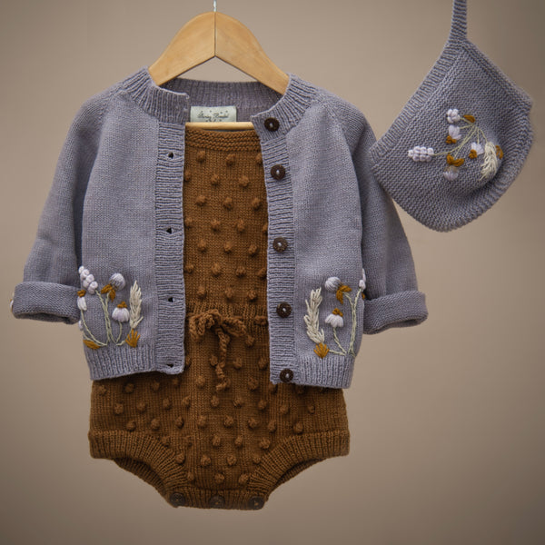 hand knitted popcorn caramel romper , lavender cardigan and the matching bonnet for kids