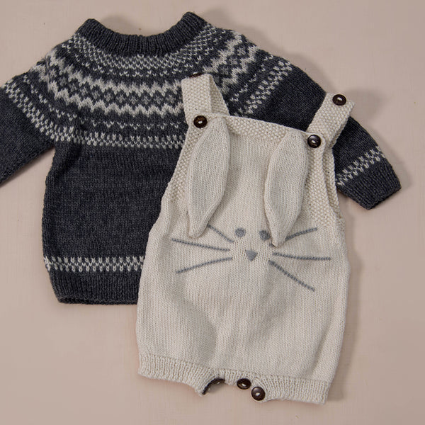 hand knitted cream white suit or romper in bunny style along with  hand knitted dark grey sweater