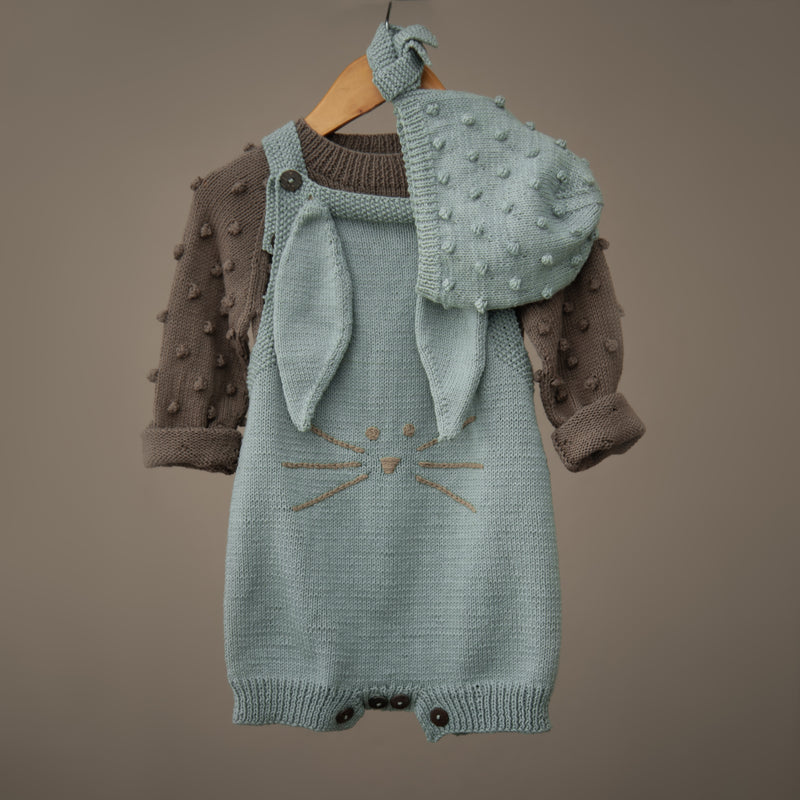 duck blue knitted bunny romper for kids paired with the matching popcorn bonnet hat and popcorn sweater in brown colour