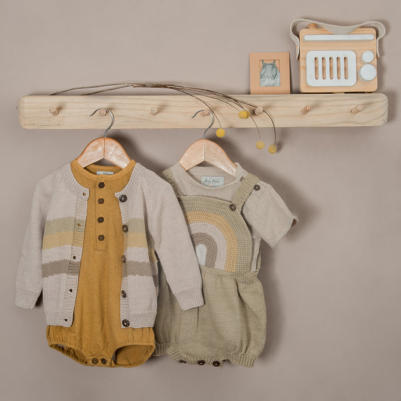 Hemp cotton romper masala and rainbow romper oats with hand knitted cardigan hanged in coat rack