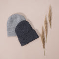 Flat lay picture of a slight oversize hat, that works so well for both mama, boys and girls. The entire hat is knitted in rib in our soft signature merino