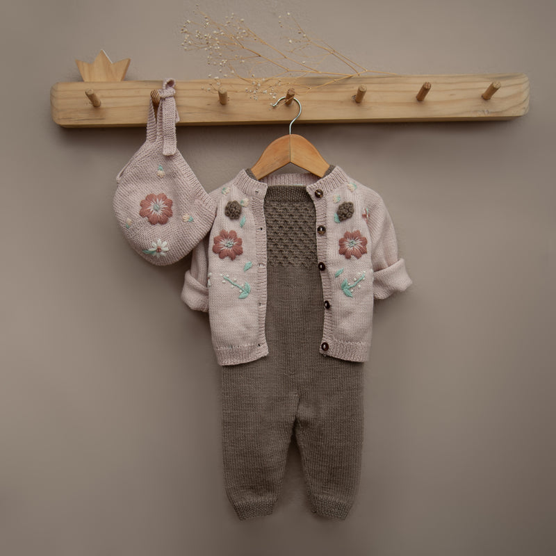 hand knitted outfit for girls with jumpsuit and pink embroidered cardigan and bonnet