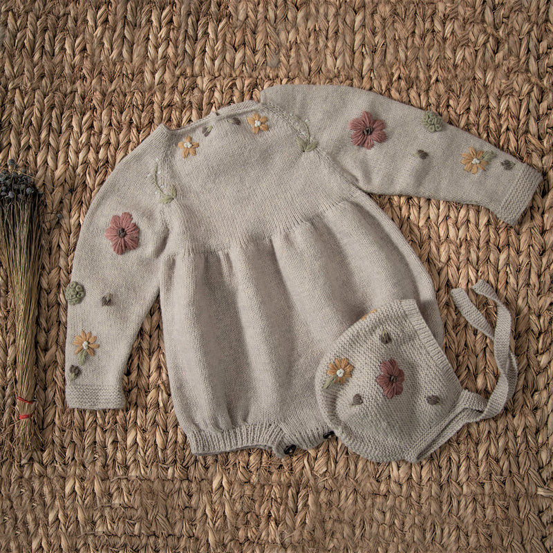 hand knitted and embroidered romper and bonnet for baby in nude colour