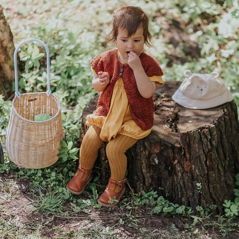 baby girl wearing half sleeve cardigan rust