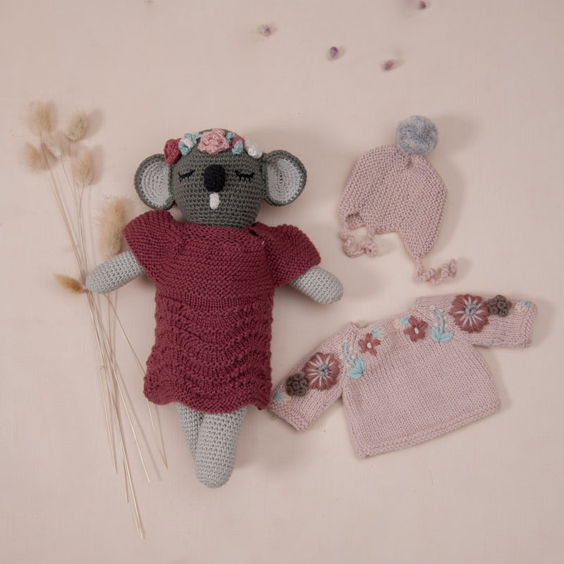 doll in knitted berry dress