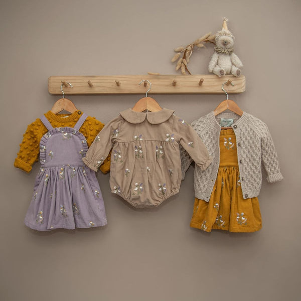 embrdoidered corduroy clothes for baby or kids on a shelfie