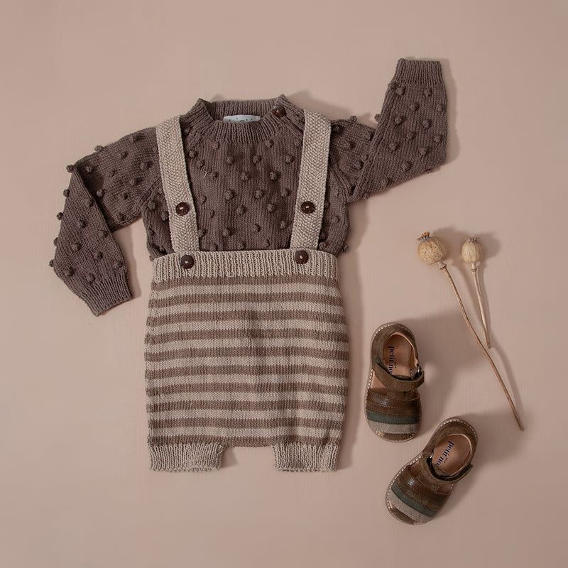 Hand knit kids wear in nutty brown, bubble style sweater with matching suspender shorts and sandals