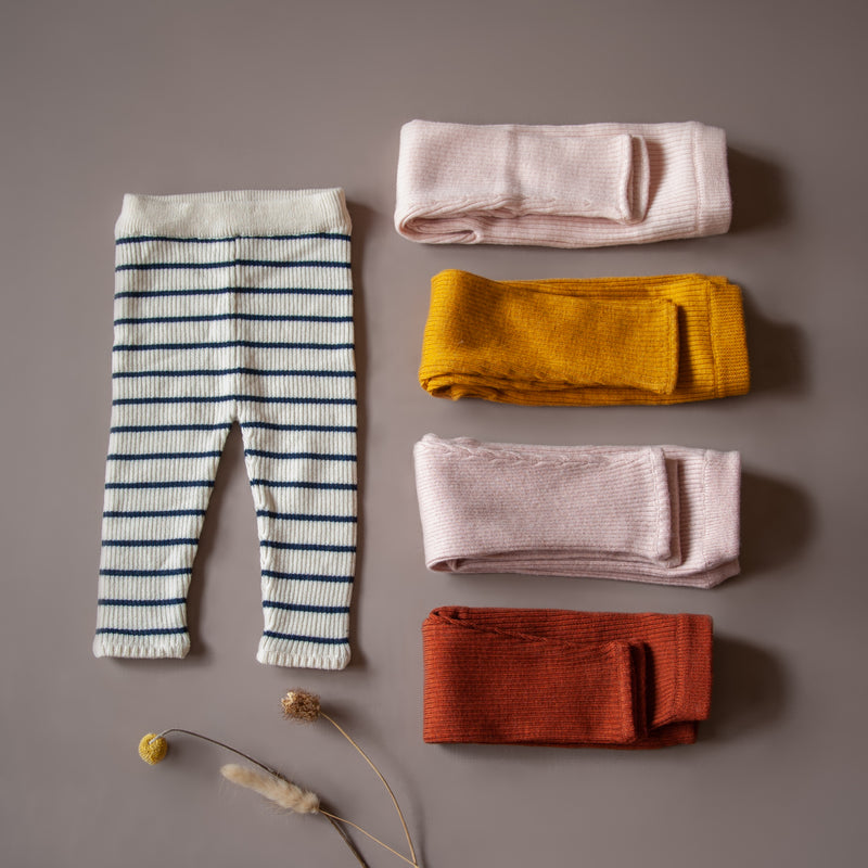 flat lay picture of baby leggings in different colors