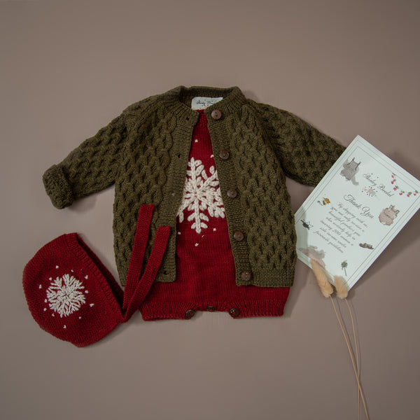 hand knitted red snowflake romper and bonnet with green wool cardigan